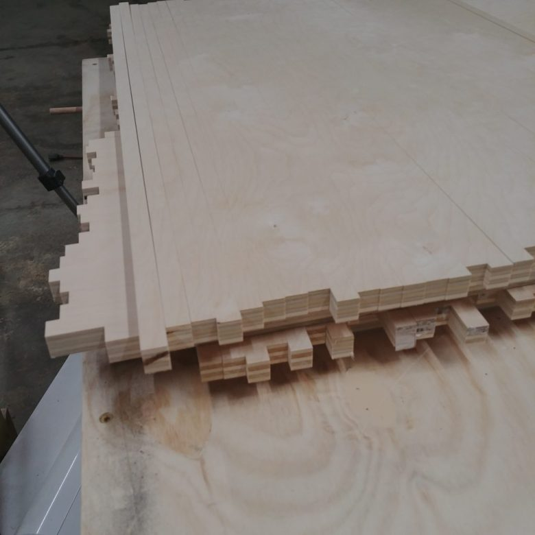 This is how we stacked all the plywood strips for the modern sliding barn door before assembling everything.