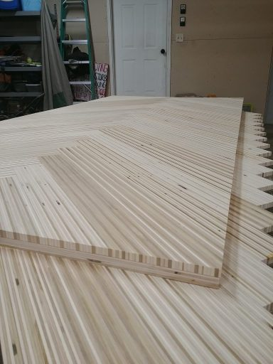 This is what the top of the modern sliding barn door looked like before we cut the bottom plywood edges off