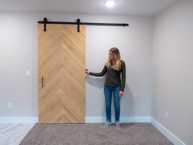 This is the finished modern sliding barn door with herringbone pattern that we sold to a realtor in our area.