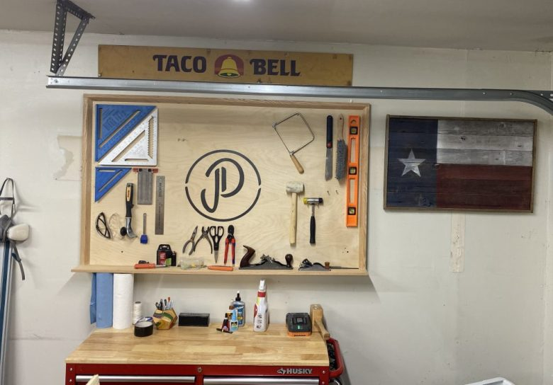 This is the tool wall we created using plywood and oak to put in our new woodworking shop
