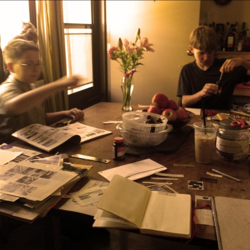 Kitchen Table Office with two youngest sons, cat, and flowers