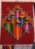 A colorful carpet or wall hanging for sale at a shop in Argentina.