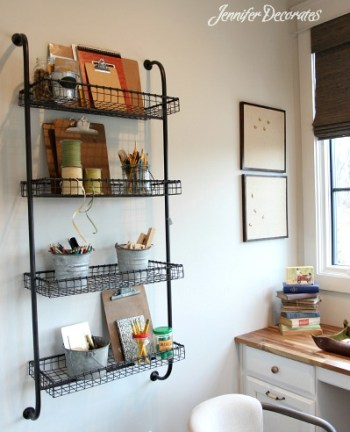 Accessorizing a bookshelf by JenniferDecorates.com