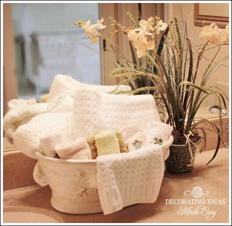 What A Lovely Way To Display Towels In A Guest Bathroom. Simply Purchase An  Ornate Ceramic Floral Container And Fill It With Lush Towels.