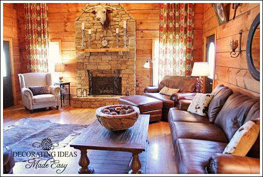 log cabin living room. A leather loveseat  couch and over sized chair was added along with an upholstered occasional The large coffee table fit perfectly in front of the Log Cabin Living Room Before After Photos