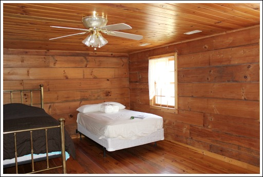 This Cabin Has Three Bedrooms, Two Downstairs, And One Upstairs.