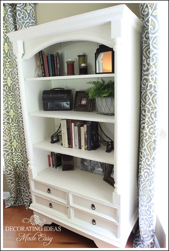 Accessorizing a bookshelf from Jenniferdecorates.com