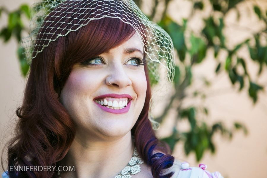photo of bride at wedding with red hair and birdcage veil
