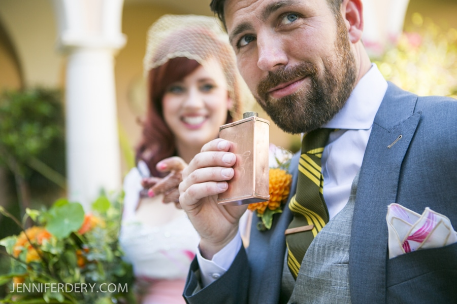 photo of groom with vintage copper flask and vintage clothing for wedding