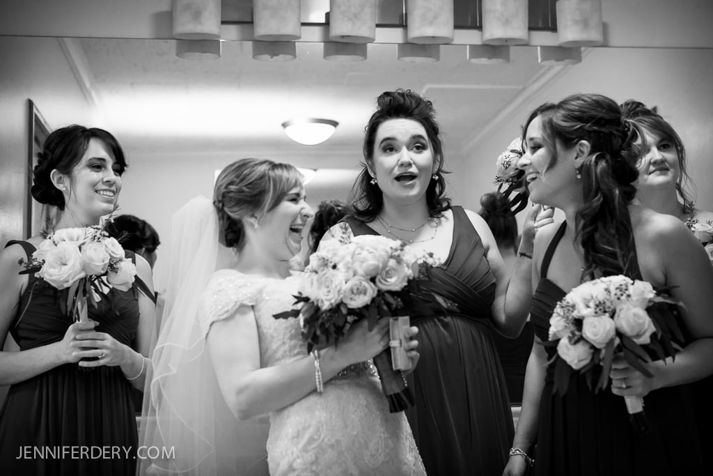 black and white photo of bridesmaids being silly