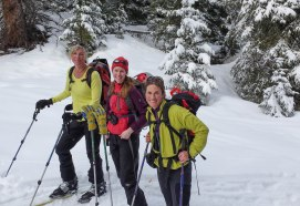 women skiing outdoors