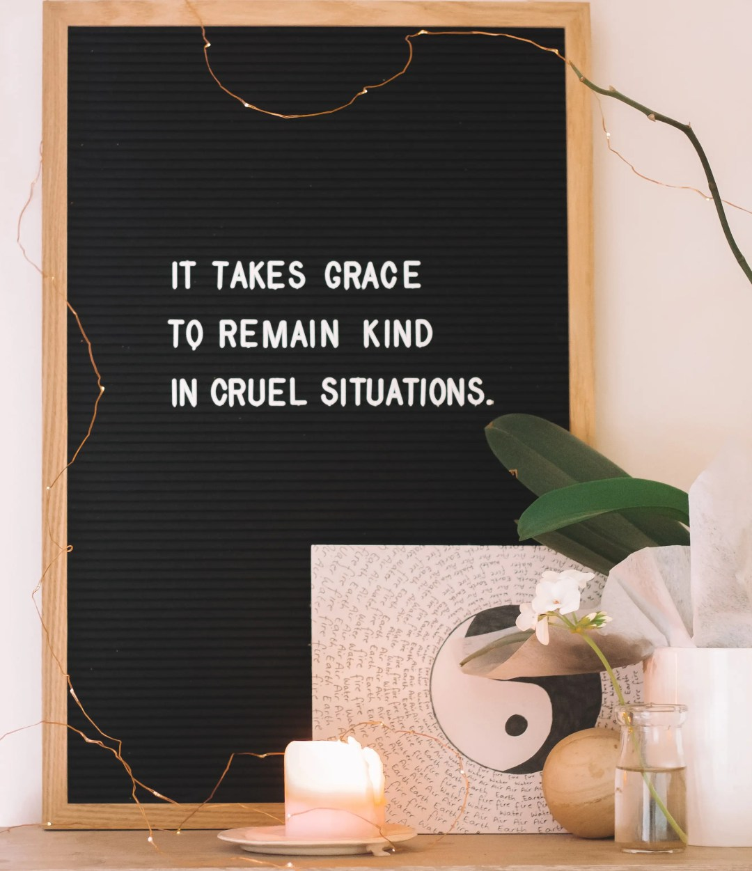 "A sign reads, ""it takes grace to remain kind in cruel situations."" This concept is often discussed in relationship counseling for singles in Dallas, TX with Rethink Therapy."