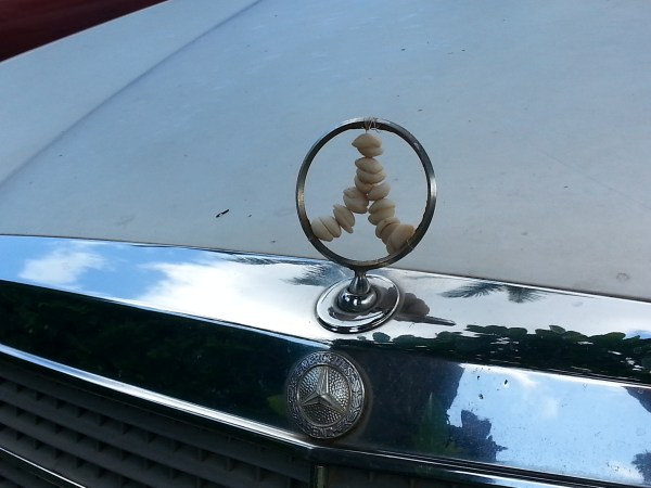 puka shell Mercedes hood ornament