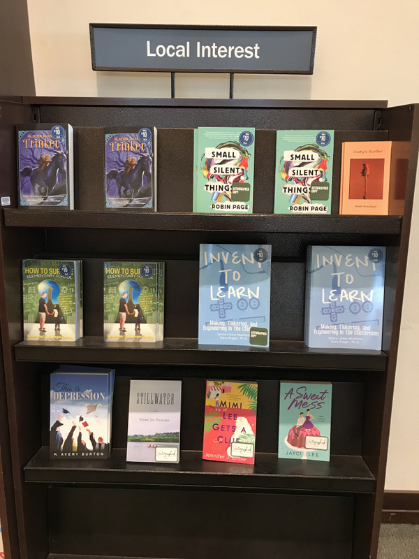 Local Interest bookcase including Mimi Lee Gets A Clue novel