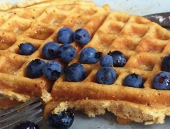 Maple syrup and blueberries make homemade waffles delish!