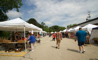 People enter the Brookfield farmers market.