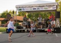 Children dance as Midnight performs.