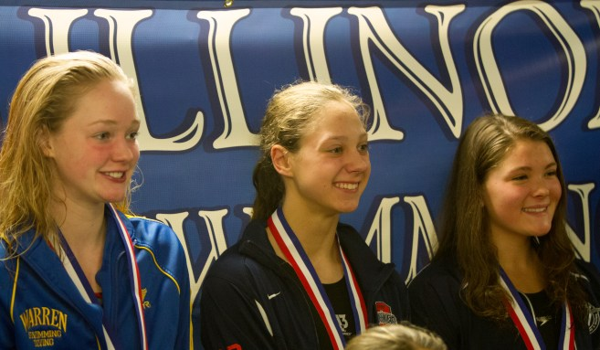 OPRF's Natalie Ungaretti poses for formal picture after being awarded for the 50-yard freestyle at the 2015 IHSA State Swimming & Diving Championship on Saturday, Nov. 21, 2015.