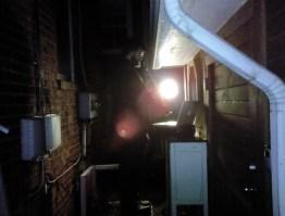 Musician (Joshua Quarles) behind existing garage window