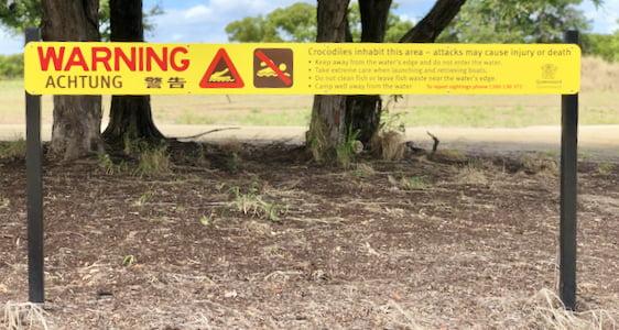 Signage warning of crocodiles.