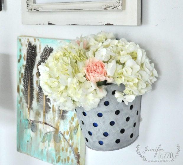 Fresh flowers in a glavanized container looks pretty as a creative vase idea