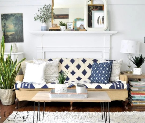 Using a throw rug as an inexpensive option to give an old couch an instant facelift.