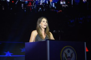 Jennifer at podium Introducing The Military Band