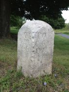 "Here's the first circa 1818 Bedford-Stoystown Turnpike marker that we found along the Lincoln Highway. Notice the typo on the left side of the stone: it says ""OT"" instead of ""TO."" (Photo by Jennifer Sopko)"