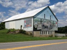 This cool mural was located on a barn across the street from the Bison Corral Gift Shop in Schellsburg, PA. Times Square in the east, Golden Gate in the west, for cross-country travel, it was the best. Lincolnway! (Photo by Jennifer Sopko)