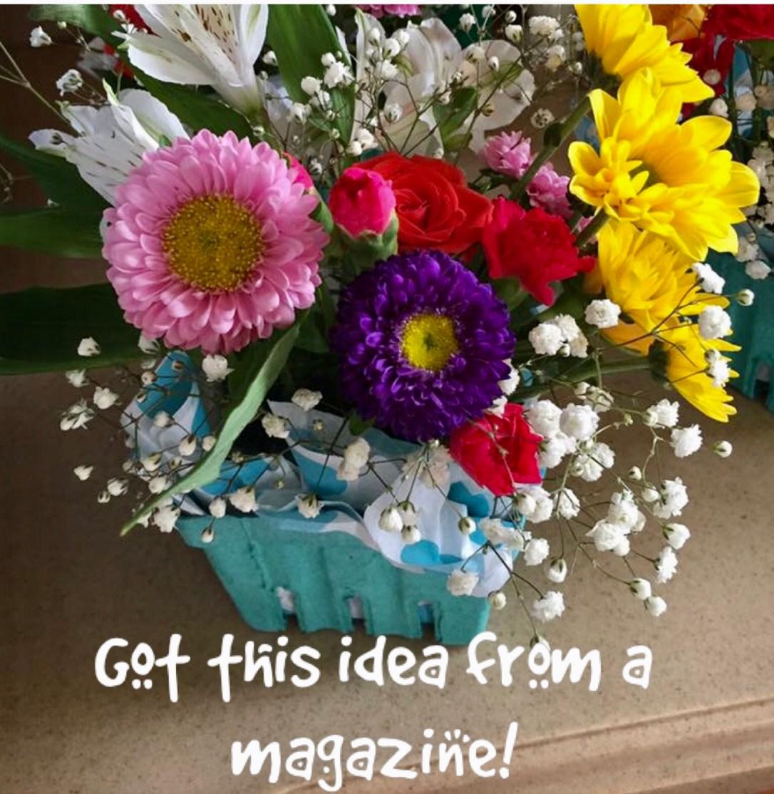 flowers in berry carton