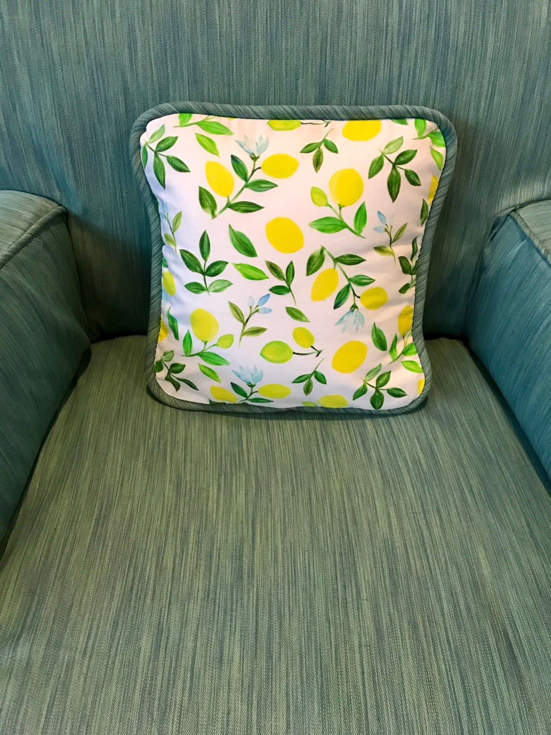 turq chair with lemon pillow