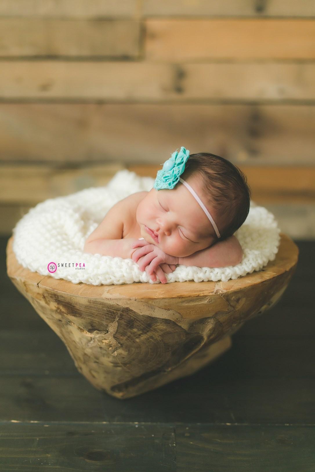 Sweet Pea baby in basket