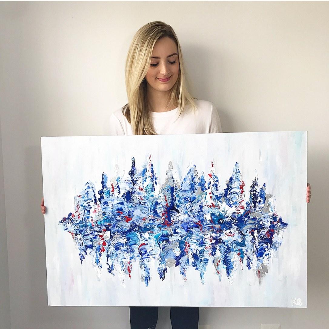 Kira holding painting