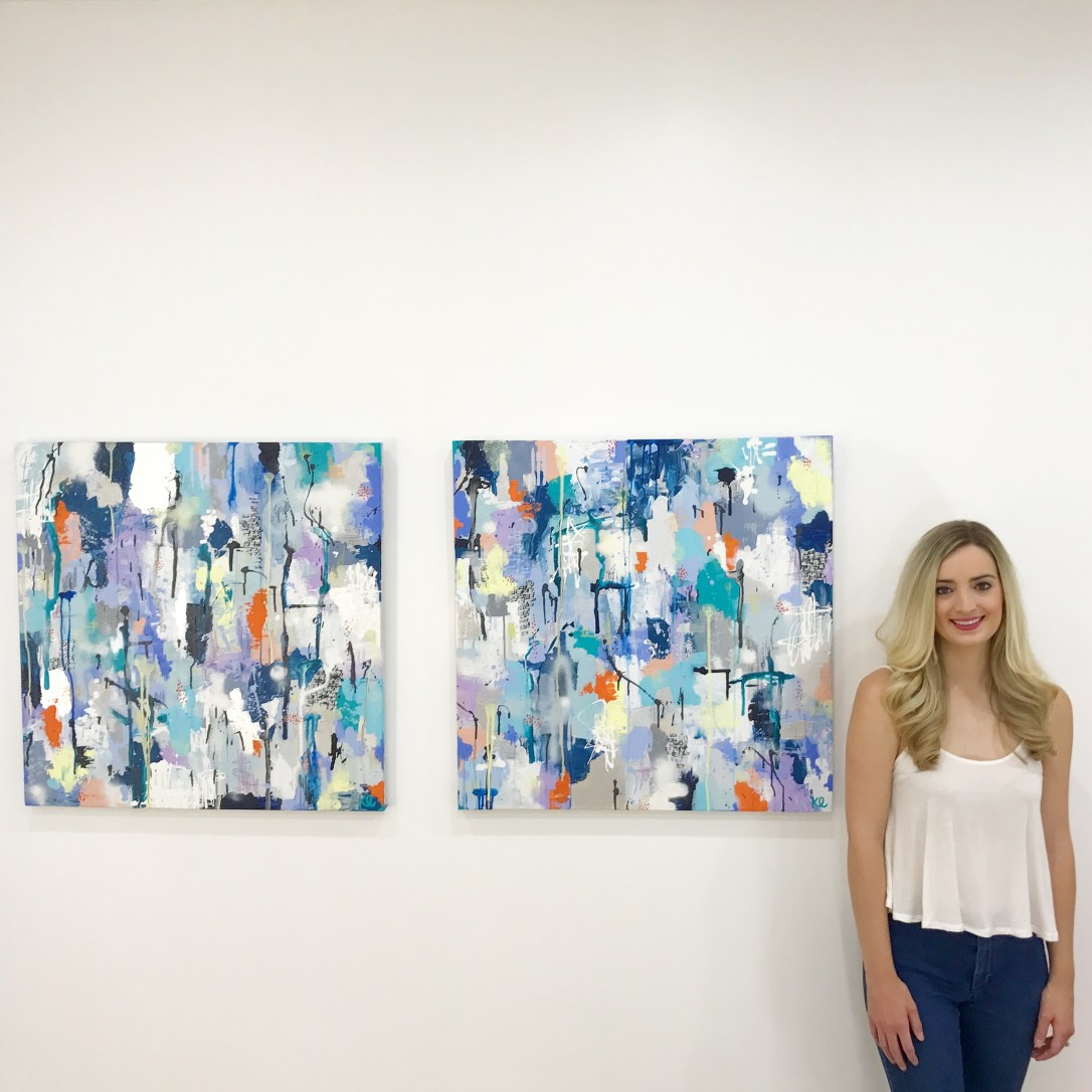 Kira with two paintings