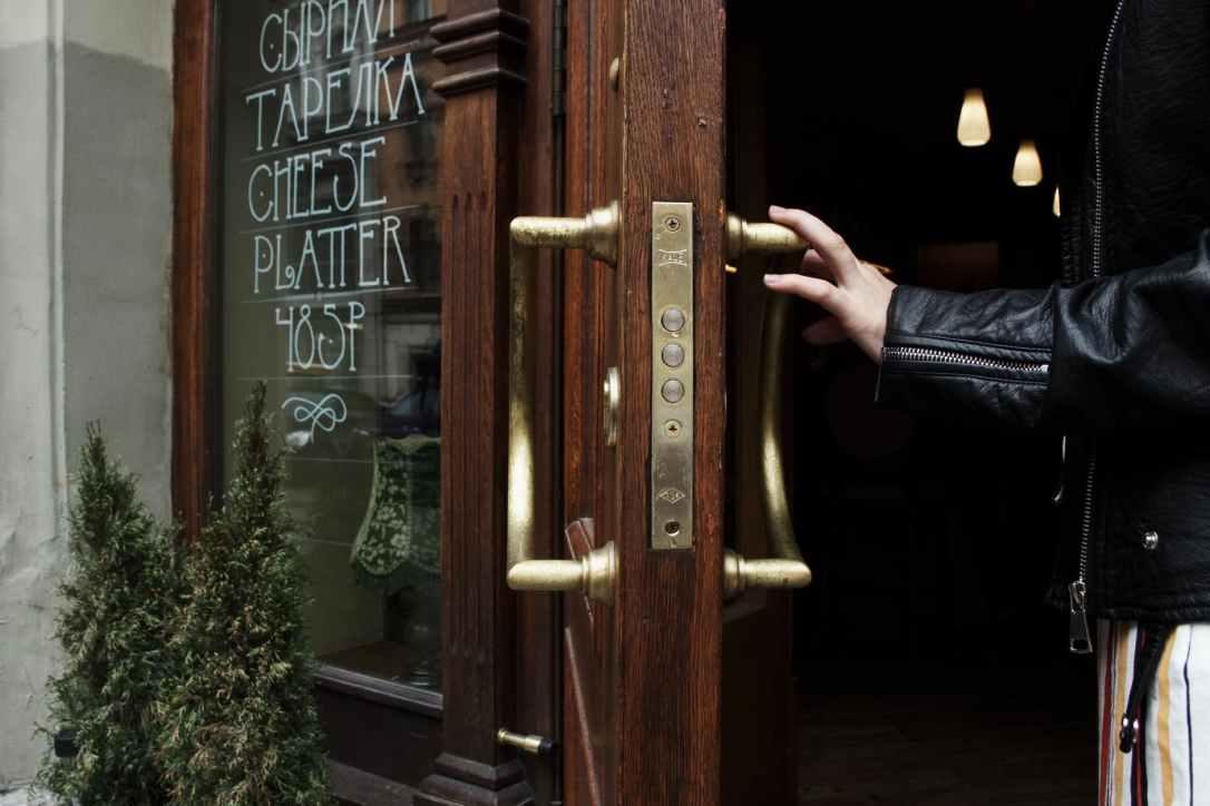 person holding door lever