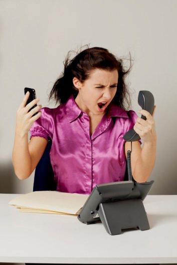 stressed businesswoman with blowing hair