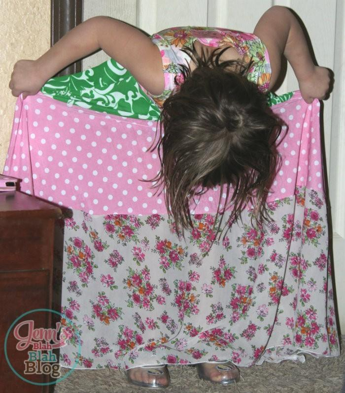 girl looking down at her new maxi dress