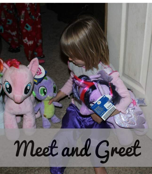toddler girl meeting and greeting her My Little Pony stuffed animal collection