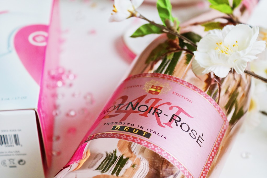 Close up photo of a pink champagne bottle