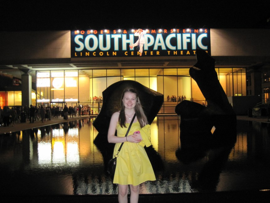 Jenny outside Lincoln Center Theater in 2010. South Pacific banner in background. Copyright Jenny Loeffler.