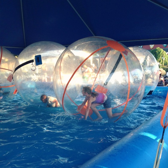 people in balls on water at the Washington State Fair