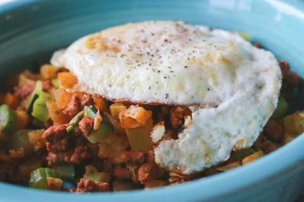 sweet potato and chorizo hash with egg on top