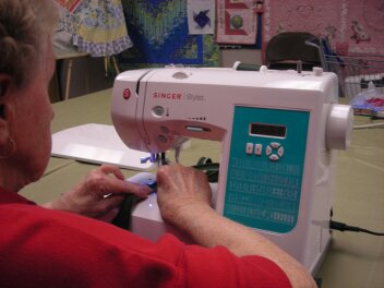 Student at Jenny's Sewing Studio is learning to sew.