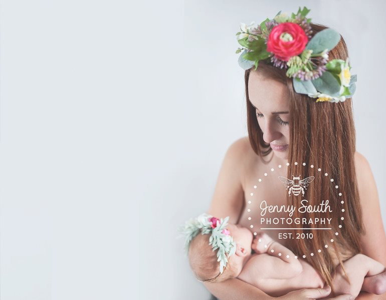 Breastfeeding mother and baby wearing flower crowns