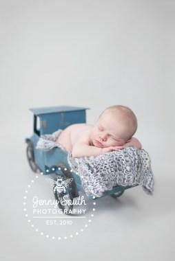 Newborn Baby Boy in vintage blue toy truck