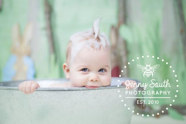 Baby boy in bath with bubbles