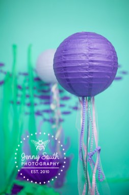 Hanging jellyfish decorations in a custom made cake smash session.