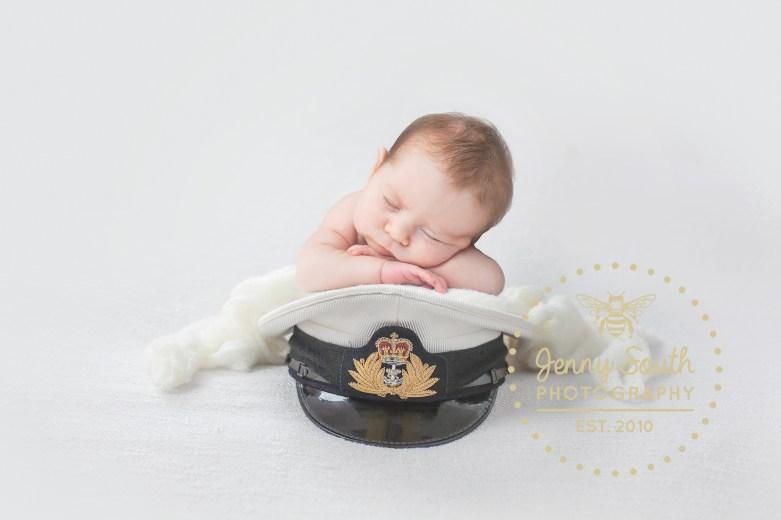 Newborn Baby sleeps on her fathers Royal Navy cap