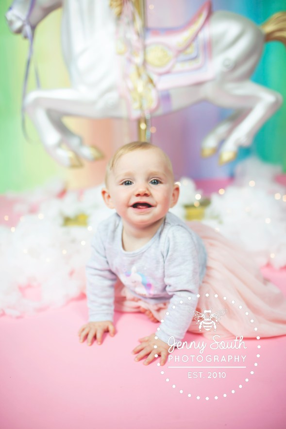 A happy smiling baby during her photo session with Jenny South Photography.