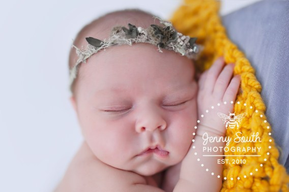 Sleeping beauty. A newborn baby sleeps with flower crown on. during her newborn session with Jenny South Photography